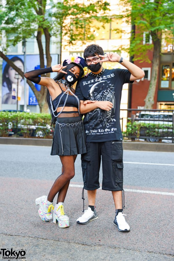 Tokyo Duo Street Styles w/ Floral Captain's Hat, Leather Chokers, WEGO Heart Chain Belt, Forever21 Pleated Skirt, Killstar Monochrome Shirt, Adidas & Current Mood Psychedelic Boots