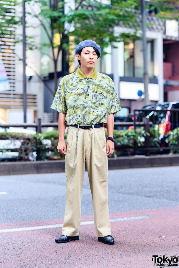 All Resale Harajuku Street Style w/ Blue Beret Hat, Printed Polo Shirt, Pleated Khaki Pants, Leather Belt, Leather Shoes, Chain Accessory & Black Watch