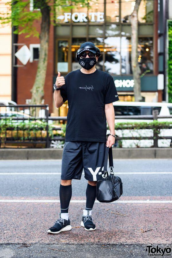 Stylist in All Black Activewear w/ Chanel Face Mask, Yohji Yamamoto Shirt, Y-3 Gym Shorts, Y-3 Gym Bag, Adidas Tubular Sneakers & Adidas Cap
