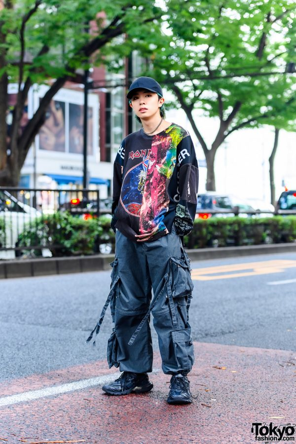 Japanese Model's Graphic Street Style in Tokyo w/ Green Hair, Black Cap, Cote Mer Iron Maiden Patchwork Shirt, Convertible Pants & Balenciaga Track.2 Sneakers