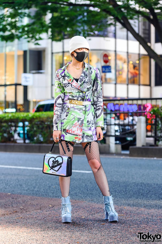 Graphic Tokyo Streetwear Style w/ Head Chains, Codona De Moda Double-Breasted Coat, Leg Harness, Ripped Fishnets, Moschino Bag & Dolls Kill Denim Booties