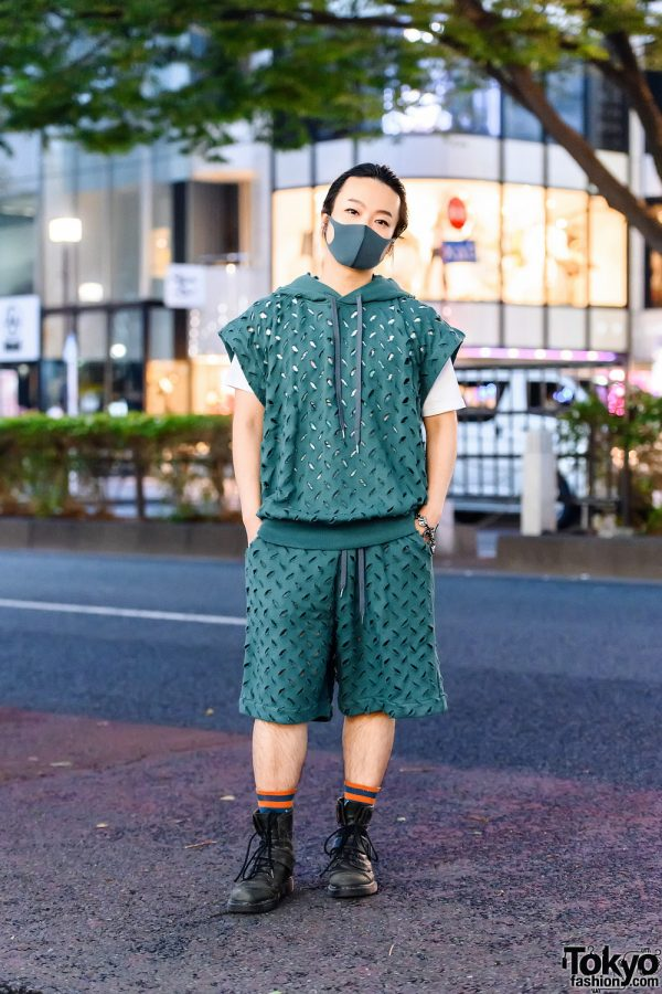 Vivienne Westwood Man Athleisure Style w/ Teal Mask, Slashed Hoodie & Drawstring Shorts, White Tee, Charm Bracelet & Dr. Martens Boots