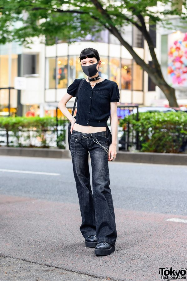 Model in All Black Street Style w/ Milk Knitted Cropped Blouse, Moussy Vintage Flared Jeans, Demonia Platform Shoes, Comme Des Garcons Bag, Tokyo Human Experiments & Vivienne Westwood Accessories