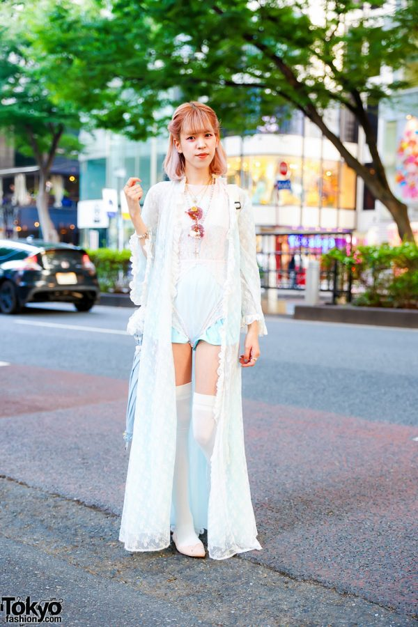 Fashion Designer in White Lace Romper, Thigh-High White Stockings, H&M Ballerina Flats, Resale Polka Dot Sling Bag, Rose Tint Sunglasses, Medallion Necklaces, Rosary Necklace & Stone-Embellished Rings