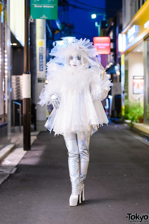 Japanese Shironuri Artist Minori in Handmade Recycled Clear Umbrella Fashion w/ Feather Eyelashes, Veiled Headdress, Silver Gloves & Platform Boots