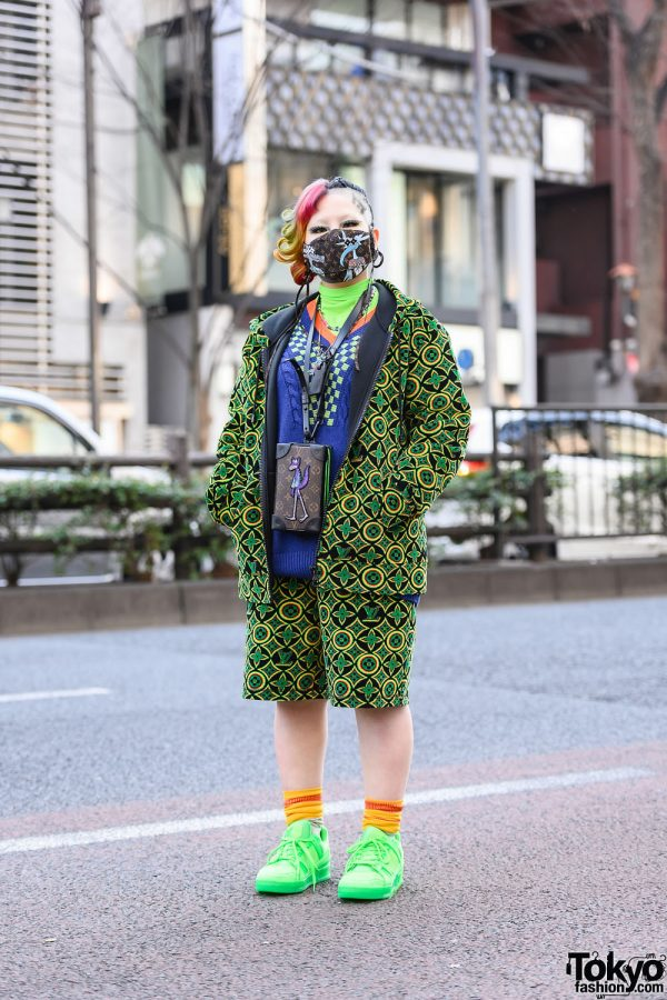 Louis Vuitton Street Style in Tokyo w/ LV Monogram Buzz Cut, Monogram Zip Hoodie Set, Damier Jacquard V-Neck Sweater, LV Zoom with Friends Monogram Neck Bag & Louis Vuitton Neon Sneakers