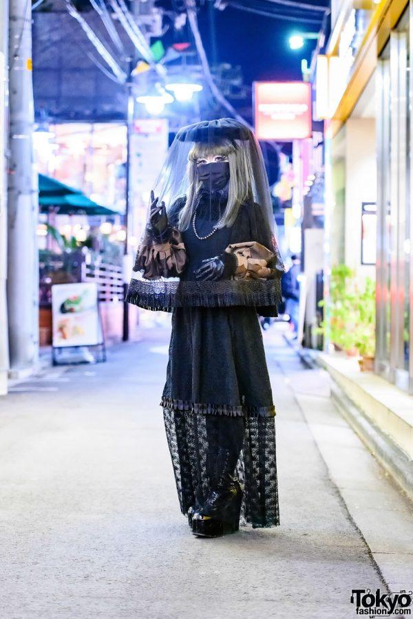 Japanese Shironuri Artist Minori Wearing A Handmade Veil & Black Lace On The Street in Harajuku
