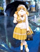 Shironuri Minori Wearing Yellow in the Rain in Harajuku