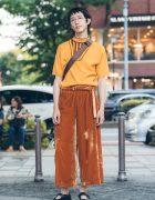 Harajuku Guy in Orange Vintage Minimalist Street Style w/ Comme des Garcons Crossbody Bag