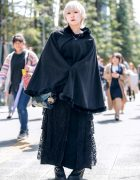 All Black Street Fashion w/ Platinum Blonde Hair, Cape Coat, Maxi Skirt w/ Lace Panel, Anna Sui Bag &a Dr. Martens Boots