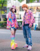 Kobinai Printed Streetwear Styles w/ Clear Bucket Hat, Orange Hair, Floral Print Jacket, Zara Ripped Jeans, Dua Lipa Shirt, Metallic Skirt, Rainbow Platforms & Adidas Sneakers