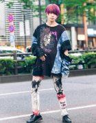 Japanese Model's Graphic Print Streetwear Style w/ Purple Hair, Chain Earrings, Cote Mer Sweatshirt, Tie Dye Pants & Dr. Martens Shoes