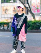 Casual Street Look in Harajuku w/ Bucket Hat, Pink Sunglasses, Codona De Moda Asymmetric Sweatshirt, Paisley Print Pants & Adidas Sneakers