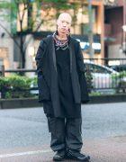 Japanese Musician & Model's All Black Street Style w/ Handmade Leather Bib Necklace, Depression Coat, Yohji Yamamoto, Vintage Pants & Nike Sneakers
