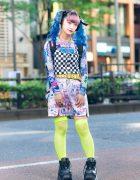 Harajuku Girl's Graphic Street Style w/ Blue Twin Tails, Checkered Top, Manga Skirt, Neon Fishnets, Sprayground Backpack & Demonia Platforms