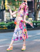 Colorful Floral Style in Harajuku w/ Ombre Hair, Handmade Floral Headpiece, Dolls Kill Bralette Top, Cropped Pants, Winged Backpack & Wedge Sandals