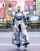 Dolls Kill Cyberpunk Harajuku Street Style w/ Striking Makeup, Asymmetrical Bob, Metallic Hooded Dress, Chain Harness, Cutout Tights & Platform Boots
