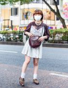 Resale Street Style w/ Oversized Pearl Necklace, Satin Camisole Dress, Faded Tee, Leather Bag & Leopard Print Wingtip Shoes