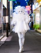 Japanese Shironuri Artist Minori in Handmade Recycled Clear Umbrella Fashion w/ Feather Eyelashes, Veiled Headdress, Silver Gloves & Platform Boots