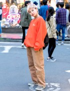 Harajuku Girl in Stussy, Carhartt & Checkerboard Vans Sneakers