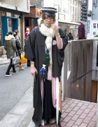 Guy in Robe, Fur Stole & Leather Cap