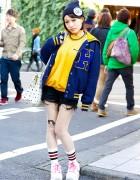 J-Pop Singer in Letterman Jacket, Cat Tights & Pin Nap Platform Sneakers