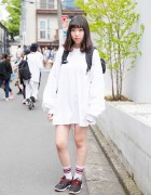 Harajuku Girl in Oversized Spinns Sweatshirt, Nike Sneakers & Backpack