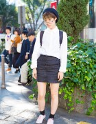 Harajuku Girl in Beret & Glasses w/ Heather Mini Skirt, I am I Backpack & La Tenace Oxfords