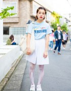 Harajuku Girl in Pleated Shorts, Graphic Tights & Nike Air Rift Sneakers