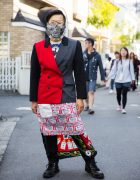 Harajuku Guy in Metal Face Mask w/ Colorblocked Coat, Scarf as Skirt & Boots