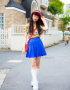 Harajuku Model/Actress in Colorful Street Style with Visor, Kiki2 Pleated Skirt & Platforms