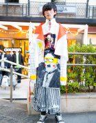Avant-Garde Japanese Street Style w/ Long Graphic Jacket by Seki, Printed Pants & Converse