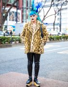 Japanese Fashion Buyer's Street Style w/ Tall Blue Hair, Furry Leopard Coat, Patent Leather Side Zip Pants, Rocking Horse Shoes & Black Makeup