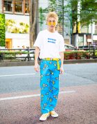 Harajuku Guy in Casual Street Style w/ White Printed Melt RAD Shirt, Golf Wang Flame Pants, Yellow Belt & Converse Sneakers
