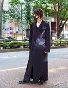 Yohji Yamamoto Street Style in Tokyo w/ Black Face Mask, Yohji Yamamoto Art Print Maxi Coat, V-Neck Shirt & Dr. Martens Boots