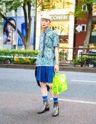 Japanese Street Style w/ Newsboy Cap, Origami Earrings, Comme des Garcons Homme Plus Pleated Skirt, CDG x Junya Watanabe Bag & YSL Metallic Boots